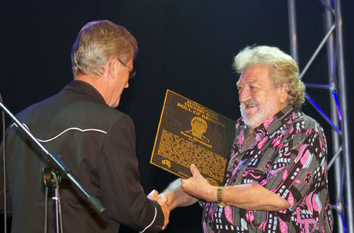 Terry Gordon presents the plaque
